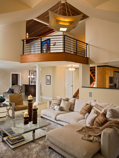 Trendy open concept light wood floor living room photo in Boston with beige  walls. Open Balcony   Houzz