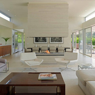 Trendy open concept living room photo in New York with a two-sided fireplace