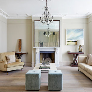 Inspiration for a traditional formal enclosed living room in London with grey walls, light hardwood flooring, a standard fireplace, a stone fireplace surround, no tv and beige floors.
