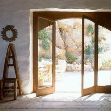Mediterranean Living Room by Deborah French Designs