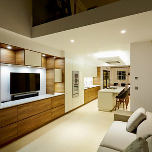This is an example of a contemporary living room in London with limestone flooring.