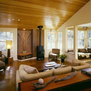 Idées déco pour un salon contemporain avec béton au sol et un poêle à bois.