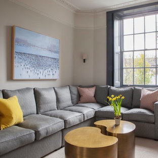 Photo of a traditional living room in London with grey walls and no fireplace.