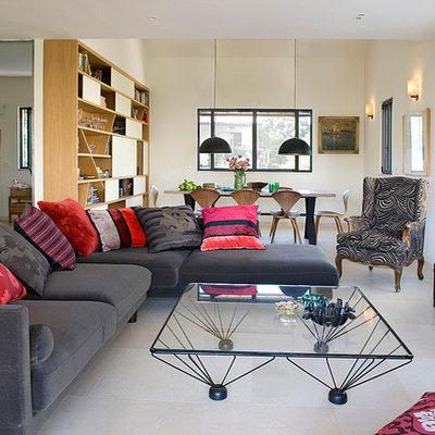 Living room - eclectic living room idea in Tel Aviv with beige walls