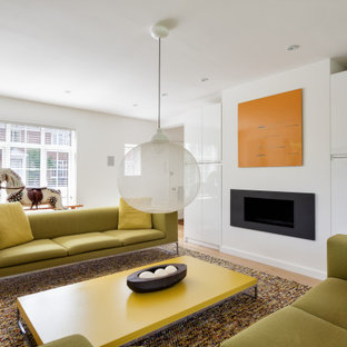 Inspiration for a contemporary open plan living room in Kent with white walls and medium hardwood flooring.