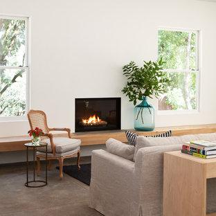 Foto di un soggiorno tradizionale con pavimento in cemento