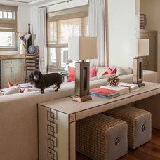 Traditional Living Room by Laura U, Inc.