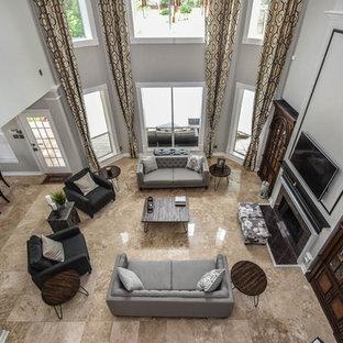 Modelo de salón minimalista con paredes grises, suelo de travertino, chimenea lineal, marco de chimenea de baldosas y/o azulejos y televisor colgado en la pared