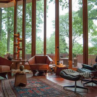 Idee per un soggiorno moderno aperto con pavimento rosso