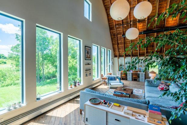 Farmhouse Living Room by Franklin & Associates - Design/Build