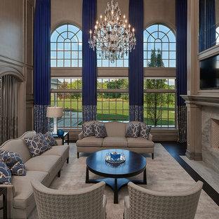 Foto di un ampio soggiorno chic aperto con sala formale, pareti grigie, parquet scuro, cornice del camino in legno, parete attrezzata e camino classico