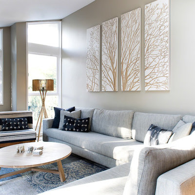 Living room - contemporary formal and open concept medium tone wood floor living room idea in Sydney with gray walls and a tv stand