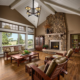 Inspiration for a craftsman formal brown floor living room remodel in Denver with brown walls, a standard fireplace and a stone fireplace