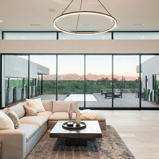 Immagine di un grande soggiorno moderno aperto con pareti bianche, parquet chiaro, camino bifacciale e cornice del camino in cemento