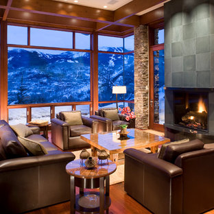 Inspiration for a mid-sized contemporary formal and open concept medium tone wood floor living room remodel in Denver with a stone fireplace, brown walls, a standard fireplace and no tv