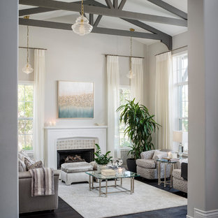 Large transitional formal and open concept dark wood floor and black floor living room photo in Los Angeles with gray walls, a standard fireplace and a tile fireplace