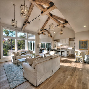 Large country open concept light wood floor and beige floor living room photo in Dallas with beige walls, no fireplace and no tv