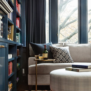 Small traditional enclosed living room in Toronto with blue walls and dark hardwood floors.