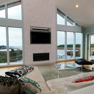 Design ideas for a large beach style open plan living room in New Orleans with bamboo flooring, a tiled fireplace surround and a wall mounted tv.