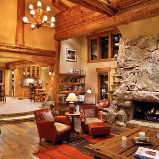 Design ideas for a traditional living room in Vancouver with a standard fireplace and a stone fireplace surround.