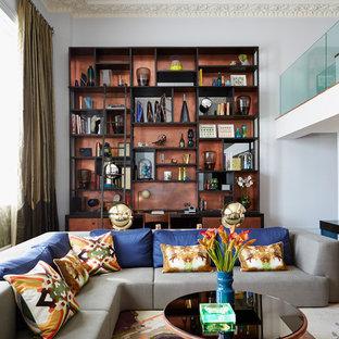 Immagine di un grande soggiorno design aperto con pareti grigie