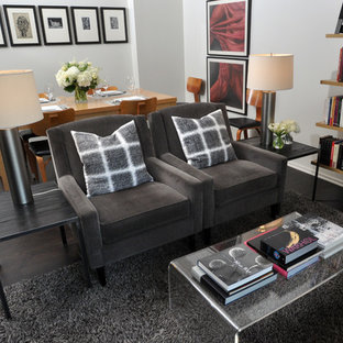 Trendy living room library photo in Chicago with white walls