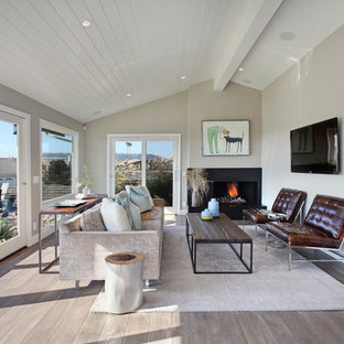 Inspiration for a transitional gray floor living room remodel in Orange County with beige walls