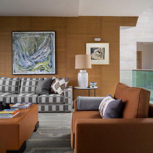 This is an example of a large contemporary formal mezzanine living room in Other with brown walls.