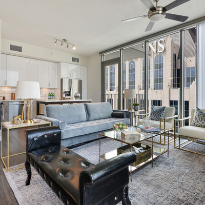 Inspiration for a mid-sized contemporary open concept dark wood floor and brown floor living room remodel in Atlanta with white walls