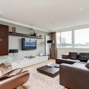 Trendy living room photo in London with gray walls and a wall-mounted tv