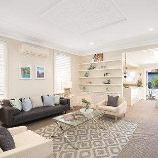 シドニーの中サイズのビーチスタイルのおしゃれなLDK (ベージュの壁、カーペット敷き、暖炉なし、テレビなし、ベージュの床、フォーマル) の写真