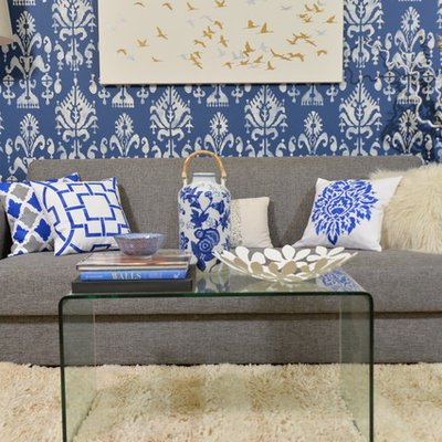Inspiration for a modern living room remodel in New York with blue walls