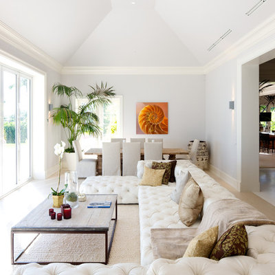 Living room - contemporary light wood floor and beige floor living room idea in Miami with white walls