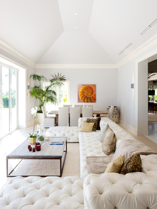 Contemporary Living Room In Miami With White Walls Light Hardwood Flooring And Beige Floors