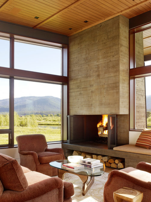 Example Of A Minimalist Living Room Design In Other With A Concrete  Fireplace Part 35