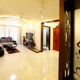 Esempio di un soggiorno minimal di medie dimensioni e aperto con sala formale, pareti bianche, pavimento con piastrelle in ceramica, nessun camino e TV nascosta