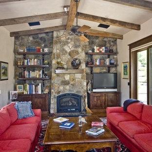 Cette photo montre un très grand salon chic ouvert avec une salle de réception, un mur beige, un sol en travertin, une cheminée standard, un manteau de cheminée en pierre et aucun téléviseur.