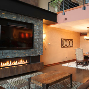Design ideas for a large urban mezzanine living room in Wichita with beige walls, concrete flooring, a ribbon fireplace, a metal fireplace surround and a wall mounted tv.