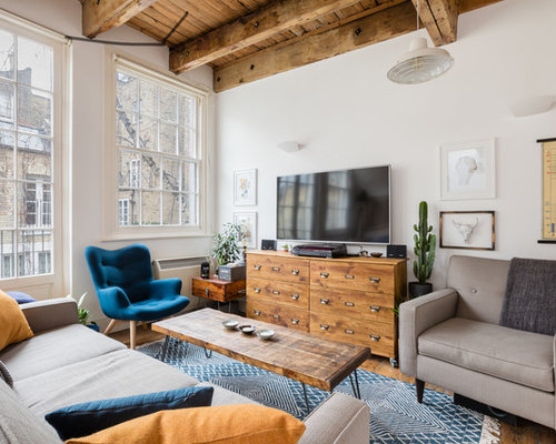 Industrial Open Plan Living Room In London With White Walls, Medium  Hardwood Flooring, A