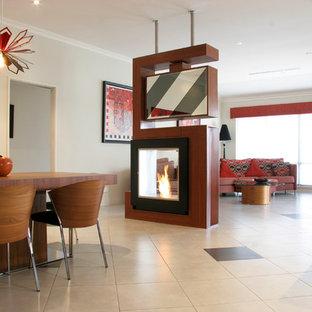 パースの大きいインダストリアルスタイルのおしゃれなLDK (フォーマル、白い壁、セラミックタイルの床、両方向型暖炉、木材の暖炉まわり、据え置き型テレビ) の写真