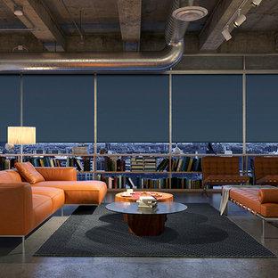 Idées déco pour un salon industriel avec un mur gris, aucune cheminée et aucun téléviseur.