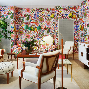Living room - mid-sized eclectic formal and enclosed living room idea in Stockholm with multicolored walls and a concealed tv