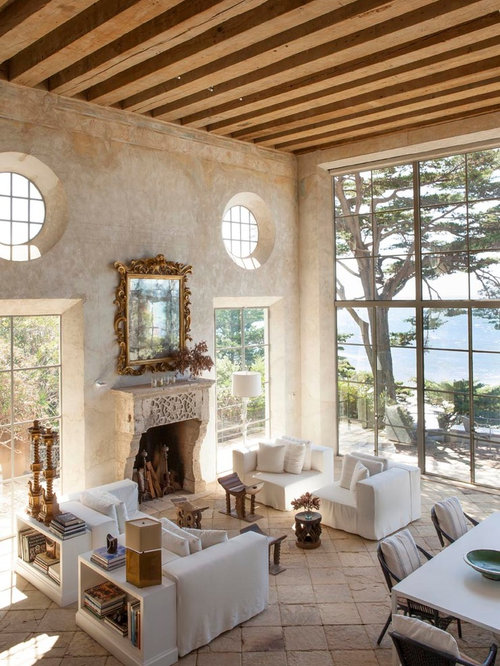 Large mediterranean formal and open concept limestone floor living room  idea in Los Angeles with beige