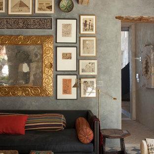 ロサンゼルスの広い地中海スタイルのおしゃれなLDK (フォーマル、グレーの壁、ライムストーンの床、テレビなし) の写真