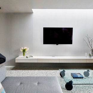 Large contemporary open concept living room in Melbourne with white walls, concrete floors, a hanging fireplace, a wall-mounted tv and grey floor.