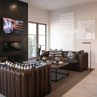 Inspiration for a contemporary formal light wood floor living room remodel in Atlanta with beige walls and a wall-mounted tv