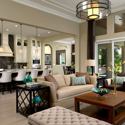 Inspiration for a transitional formal and open concept living room remodel in Orlando with beige walls