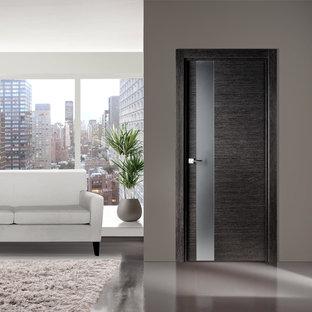 Immagine di un soggiorno minimalista di medie dimensioni e chiuso con pareti grigie e pavimento in linoleum