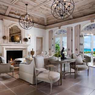 Mid-sized tuscan open concept and formal ceramic floor and beige floor living room photo in Denver with white walls, a standard fireplace, a stone fireplace and no tv