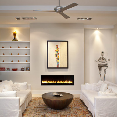 Living room - contemporary living room idea in Tampa with beige walls and a ribbon fireplace